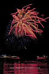 Traverse City fireworks 2 (deeindiana) Tags: sky usa lake holiday color reflection water night america dark bay boat colorful fireworks michigan stock explosion celebration reflect american stockphotos burst traversecity westbay grandtraversebay stockphotography cherryfestival traversecitymichigan nationalcherryfestival eventphotographer travelphotographer debperry debperrystudio traversecityphotographer