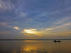 River Ganges at dawn, Varanasi (jonhuskisson) Tags: travel sunset india sunrise worship asia day cloudy holy backpacking sacred varanasi hindu hinduism ganges placeofworship