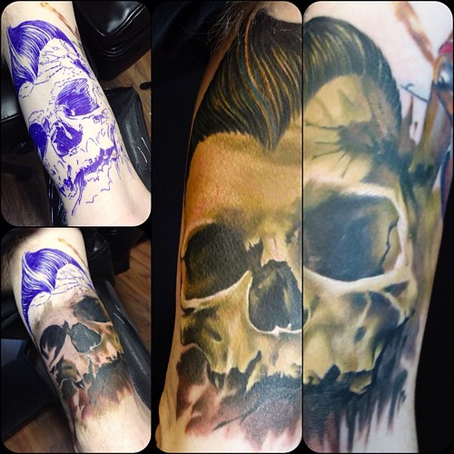 Color Skull Tattoo With The Pompadour On Inside Of