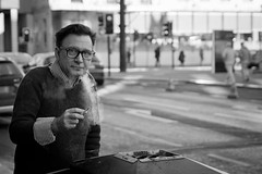 Out Through The Nose (Leanne Boulton) Tags: life street city portrait people urban bw white man black monochrome canon glasses scotland blackwhite glasgow cigarette candid smoke scene smoking human ashtray smoker