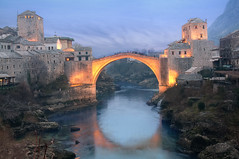 Mostar, Bosnia and Herzegovina [Explored] (Meleah Reardon) Tags: old bridge blue people night clouds war no mostar bosnia calming hour herzegovina magical impressedbeauty pwpartlycloudy
