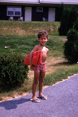 Bobby on the way to the pool (epicharmus) Tags: ranch trip boy summer vacation ny newyork kid child path lawn upstate towel adirondacks resort lakegeorge flipflops upstatenewyork 1973 colorslide 35mmslide warrencounty daddino roaringbrookranch robertdaddino
