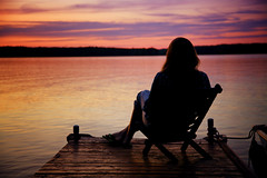 tranquility (thatgirlwiththekicks) Tags: wood pink sunset summer sky orange woman lake ontario canada girl clouds self evening dock chair sitting purple dusk timber peaceful tranquility canadian calm resting moment crowelake