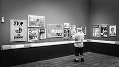 Stop The Burning (Sean Batten) Tags: pictures england blackandwhite bw london museum person nikon gallery unitedkingdom posters adverts d800 southkensington vamuseum 1424