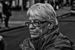 IMG_9262-Edit (roger_thelwell) Tags: life street city uk winter portrait england people urban bw white black streets cold london lamp monochrome westminster beauty hat rain leather mobile umbrella hair bag walking real photography mono chat shiny phone traffic post natural photos britain circus cigarette candid cab taxi great over sac hats cell photographic smoking lamppost photographs oxford conversation shiney talking shoulder handbag stud speak speaking studs commuters scak