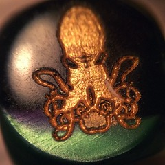 I was recently gifted with a lovely pair of Cthulhu dice. They're strangely heavy in my pocket and sometimes they feel so cold my skin seems to be burning, but I've no doubt they'll come in handy when I've got tentacular decisions to make. (liquidnight) Tags: dice macro square die collections squareformat cthulhu collecting tentacles tentacular cthulhufhtagn iphoneography instagramapp xproii uploaded:by=instagram