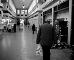 A Man Shopping in the Grainger Market - Newcastle (Richard James Palmer) Tags: street new uk portrait england urban blackandwhite white abstract black art 120 mamiya film monochrome newcastle photography trapped shoot gloomy iso400 fineart north streetphotography documentary rangefinder gritty ishootfilm tyne east iso ilfordhp5 400 walkabout epson hp5 medium format analogue melancholy northern northeast ilford f4 isolated upon newcastleupontyne 1125 80mm tyneandwear 2016 v700 mamiya7ii microphen filmisnotdead 7ii ilfordmicrophen epsonperfectionv700