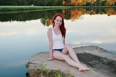 Redhead (PhotoAmateur1) Tags: pink blue autumn sunset red woman white reflection sexy fall feet water beautiful beauty smile face crimson smiling fashion shirt female clouds contrast scarlet hair neck skinny outside outfit model glamour eyes colorful toes long pretty tank arms legs head top feminine background gorgeous chest femme butt fingers young style lips september redhead jeans attractive bracelet denim shorts lovely thin cleavage throat slender stylish