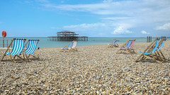 Not Long Now..... (Fourteenfoottiger) Tags: blue sea summer sky beach clouds coast pier spring waiting view chairs empty pebbles westpier deserted stripy