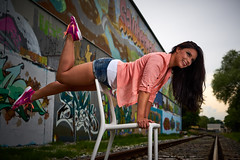 On top of the chair (CHCaptures) Tags: railroad woman graffiti model chair outdoor brunette graz sporty
