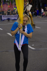Flag Carry (swong95765) Tags: woman girl tattoo female march parade blonde carry flage