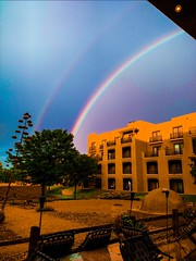 rainbow sky clouds light color adobe building structure... (Photo: Thad Zajdowicz on Flickr)