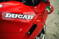 Ducati in red (Eric Flexyourhead (shoulder injury, slow)) Tags: red canada detail bike zeiss italian bc britishcolumbia vibrant vivid motorbike motorcycle northvancouver ducati fragment waterfrontpark shallowdepthoffield fairing 2016 55mmf18 italianfrenchcarbikefestival sonyalphaa7 zeisssonnartfe55mmf18za