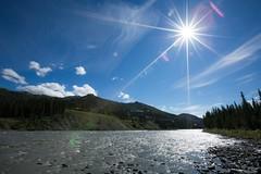 Sun burst (Sophia Ludwig) Tags: blue trees sky sun mountain lake hot green water alaska clouds rocks stream sunburst denali