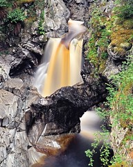 Falls of Bruar: Natural Arch (ShinyPhotoScotland) Tags: camera light colour art nature water beautiful composition manipulated river lens landscape photography scotland raw dynamic emotion affection unitedkingdom perthshire dramatic places equipment filter zen rivers balance flowing colourful geology areas awe striking toned contrasts rugged imposing turbulence elegance shapely gbr circularpolariser naturalarch rockstone sumptuous digikam rockwater tonemapped nd4 olympuspenf bruar shapeandform dulllight rawconversion fallsofbruar intimatelandscape rawtherapee psammite naturehappens bruarwater luminancehdr olympus1260mmf28 motionstationary timefulness