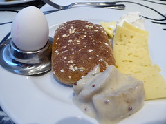 First breakfast plate waiting for me (seikinsou) Tags: summer food cheese breakfast restaurant hotel midsummer sweden egg butter diningroom meal herring umea scandic