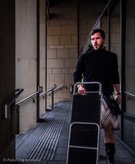 Missoni Kiltie contemplates luggage load (FotoFling Scotland) Tags: scotland edinburgh kilt porter missoni