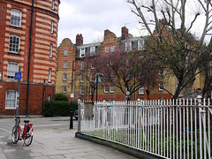 The Street Corner (Louise and Colin) Tags: old uk england building london english heritage history bike bicycle fence spring britain bricks flats shoreditch housing british councilestate socialhousing hff blockofflats arnoldcircus 2013 boundaryestate whiterailings spitalfieldslondon rochellestreet happyfencefriday