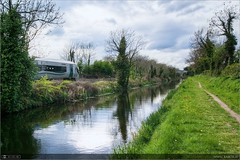 Into Uncertain Skies (bbusschots) Tags: reflection clouds train canal rail pathway irishrail kildare dmu kilcock classie22000dmu3