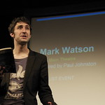 Mark Watson reads to the audience in 2008