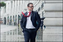 red tie and rain (jonron239) Tags: winter man london rain wind expression tie regentstreet suit geezer geezerwednesday