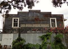 Broom Works (tmvissers) Tags: eastvillage metal fence downtown sandiego bougainvillea broom corrugated jstreet broomworks