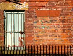 Wheres my window ? (raspu) Tags: door uk inglaterra england house building brick ladrillo window manchester ventana reja casa puerta edificio lancashire adobe vivienda