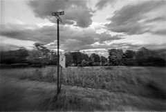 Corner (robert schneider (rolopix)) Tags: sky blackandwhite bw lake signs blur 120 film monochrome field clouds analog corner mediumformat vermont newengland 6x9 agfa ilford fp4 vt clack lakechamplain flippedlens fp4plus southhero 120620 autaut bwfp believeinfilm