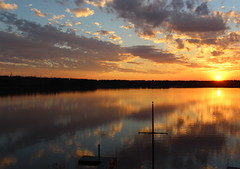 Reflections of sunset over Lake Crabtree (Sam0hsong) Tags: sunset day cloudy lakes northcarolina lakecrabtree partycloudy