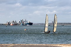 Work and Play on the Water (tonydickins) Tags: sea sky water docks canon boats eos pier waves sailing ship wind jetty ships catamaran solent tugboat dslr southampton tugs esso refinery bouys tankers cobalt petroleum sushine calshot skiffs 600d