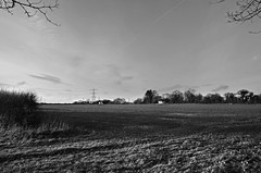 Little Houses on the Prairie (Bud_um_tiss) Tags: blackandwhite house monochrome countryside interesting scenery scenic sigma hampshire pylon 1750 hambledon hants sigma1750