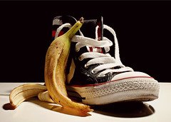 romeo & juliet (brescia, italy) (bloodybee) Tags: shadow red stilllife food white black macro love yellow fruit fun shoes sweet humor shakespeare banana trainers eat converse strings peel sole romeoandjuliet allstars 365project