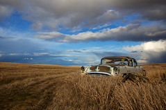 Davenport to Reardan (Flint Roads) Tags: old blue usa storm abandoned field grass car rain weather clouds rural washington buick shadows decay bluesky faded vehicle wa lonely forsaken reardan