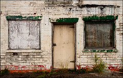 Imperfect Symmetry (Junkstock) Tags: door wood old blue windows color building brick green abandoned window architecture rural photography photo washington paint doors exterior decay bricks rustic nostalgia photograph nostalgic americana weathered aged decayed patina oldstuff oldandbeautiful agedwindow