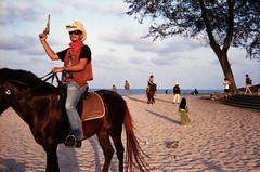 * (Sakulchai Sikitikul) Tags: street leica horse seascape beach zeiss thailand 50mm evening cowboy streetphotography 15 snap 200 carl songkhla ttl agfa m6 sonnar 085 samilabeach vistaplus