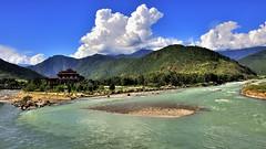 Punhaka Dzong at reunion of Pho and Mo, Bhutan (flowerikka) Tags: mountain clouds landscape temple bhutan kingdom monks himalaya punakha riverpho rivermo
