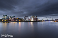 Blue on the Tyne (rickyschonewald) Tags: longexposure bridge sky reflection water buildings newcastle lights movement cityscape cloudy riverwear tynebridge northeast darkclouds thesage thebaltic sigma1020 juryinn nikond3100 rickyschonewald millenuimbrigde