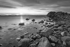 Moutmarka (Normann Photography) Tags: sunset sea blackandwhite bw reflection monochrome norway blackwhite rocks stones no pebbles mesmerized tjme vestfold moutmarka monoart