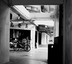 IMG_1078 (jumppoint5) Tags: city light urban blackandwhite building bicycle shop contrast shadows estate hdb