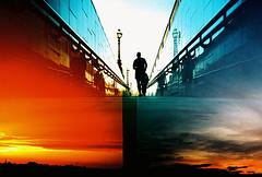 Lomo  run a red light (lomomowlem) Tags: city sunset urban london film lomo xpro lomography xprocess doubleexposure crossprocess lofi tunnel redsky analogue halfframe runner expiredfilm kodakelitechrome ebx colourstreambrighton