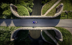 Consignment (Draws_With_Light) Tags: camera bridge england water bicycle architecture season landscape cycling canal spring unitedkingdom structures melbourne places scene vehicles gb activity aerialphotography drone eastridingofyorkshire pocklingtoncanal churchbridge davidhopley djiphantom3advanced