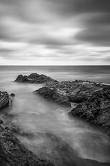Reef Point - Somber Mood (www.karltonhuberphotography.com) Tags: longexposure sky blackandwhite bw seascape texture beach nature lines weather clouds landscape outdoors rocks moody gloomy dismal details overcast pacificocean southerncalifornia drama somber unsettled naturalworld stormclouds californiacoastline softlight grayday 2016 flowingwater reefpoint silkywater unstableairmass karltonhuber