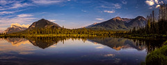 Vermillion lake (#Explored 04-06-2016) (wimvandemeerendonk) Tags: park blue trees light sunset wild sky panorama cloud sun mountain lake canada color colour reflection tree green nature water colors rock clouds contrast forest landscape outdoors gold golden rocks heaven colours minolta bright outdoor sony hill hills alberta valley wetlands land banff ripples goldenhour vermillion monumental mountainscape vermillionlake wimvandem