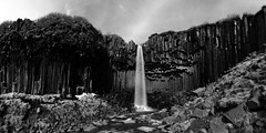 a natural cathedral to worship Earth (lunaryuna) Tags: longexposure bw panorama monochrome beauty river season landscape blackwhite waterfall iceland spring rockface le lunaryuna svartifoss skaftafellnationalpark southiceland columnarbasalt hiddenbeauty seasonalchanges skaftafellmountainrange