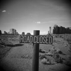 Road Closed #2 (LowerDarnley) Tags: holga monumentvalley utah navajo nation southwest arizonaborder sign closed buttes mesa road