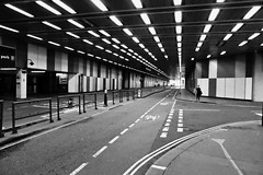 Under the Barbican. (Steve.T.) Tags: road street city urban blackandwhite london lines lumix lights tunnel streetscene barbican panasonic cityoflondon converging converginglines thebarbicancentre inatunnel dmctz40