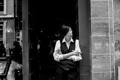 Take a break (EyeOfTheLika) Tags: life street blackandwhite bw woman black london work real uniform chinatown break cigarette candid soho streetphotography lifestyle smoking lika bnw streetbw 500px ifttt