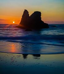 Deep Blue Sea (intrazome) Tags: ocean longexposure blue light sunset red sea orange sun seascape nature water silhouette rock landscape coast nikon cornwall waves wave nd porthcothan sigma1770 d5100