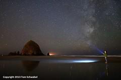 Pondering the Universe (pdxsafariguy) Tags: ocean reflection beach night oregon stars flashlight astronomy cannonbeach haystackrock stargazing milkyway tomschwabel