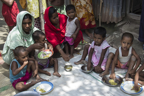 Mothers feed their children in Rangpur, Bangladesh. Photo by Holly Holmes, 2013